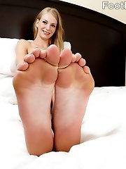 Erika wants to get her feet worshipped, and she is going to get what she needs. She wants to wrap her feet around a cock and jerk it for us. She can\'t wait to have her toes sucked on while she is getting fucked. You can see how much she loves it when that cum hits her pretty feet.