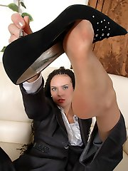 Raunchy business woman in open toes pantyhose doing exercises on the sofa
