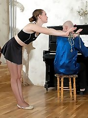 Flexible dancer teasing pianist with her seductive feet clad in lacy tights