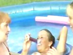 Amateur mature backyard lesbians take turns playing with pussies in a pool