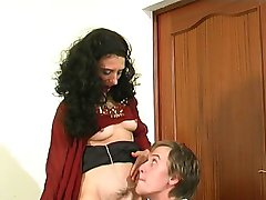 Mature brunette fucks a young man