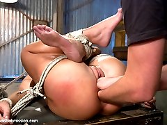 Roxy Raye submits to bondage and rough sex and is dominated with a mans fist in her pussy and...