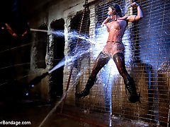 Ariel X gets bound hard and tight. Her fitted form is zip tied to the fence, displaying her body...