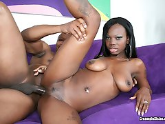 Sweet looking black babe riding an ebony dick like a champ