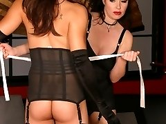 Horny dominatrix Christina Aguchi punishes her female submissive partner with her whip