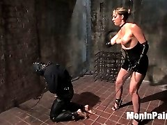 When the need for a house gimp came up, I looked to Miss Delilah Strong to train one.  She is a very tough and experienced player, and she recently starting domming for the company.  In her first MIP shoot she shows amazing drive and initiative in drilling our measly worm boy to his knees where he belongs.  Once he is taken down a peg, she teaches him the proper way to fuck and suck a woman through strict and painful lessons that he will not soon forget.