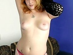 Hirsute model Cherry Poppers show off her sultry tits and examining her thick bush with a comb