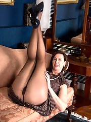 Blatantly kinky, Lara gets her hands inside the sheer warm nylon to spread and frig her wet nyloned hole.