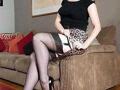 Glamorous Red makes a close friend with a daring display, stripping down to open bottom girdle...