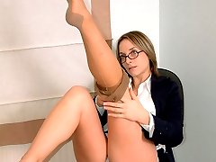 Office girl taking off her tanned stockings