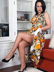 Retro fan Lucy gets hot and wanton in her deep garter belt nylons and heels for you!