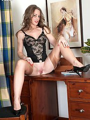 Naughty secretary plays in her sexy lingerie and tan nylons!