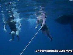 Nastya and Masha are swimming nude in the sea