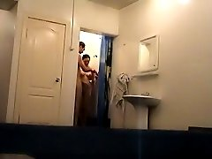 A couple takes a shower unaware of spy cam