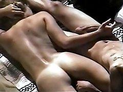 Nudist couple makes handjob at beach