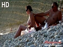 Luxurious nude beach girl with great sappy boobies gets taped on cam of nudist beach hunter