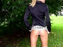 Naughty chicks display ass and tits outdoors