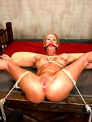 Sexy bondage MILF ,Simone Sonay, plays out her real fantasy and gets dominated and fucked by two sadistic security guards.