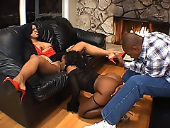 Two black chicks with perfect curves tag team a black cock