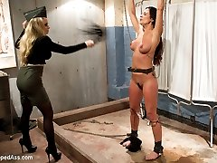 Former Wicked contract star, beautiful? Sure. Tough as nails? You\'ll have to see it to believe it! Welcome Kirsten Price to Whipped Ass. Not only is she drop dead gorgeous but she loves BDSM. In this kinky lesbian roleplay Kirsten is a new recruit for the military but they have other plans for her training. Kirsten is subjected to tough caning, single tail, evil clothes pins ripped from her tits with water and then made to cum. She\'s put in back bending bondage spanked and fisted to orgasm then wrap in medical wrap and double penetrated and cums from anal penetration!
