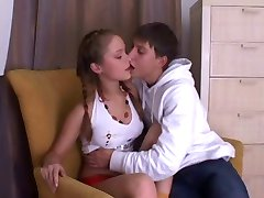 cute young russian couple have sex on sofa
