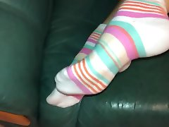 girl removes socks and show feets