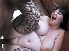 Busty fattie in lovely fishnets rides a hung black guy to get a commission
