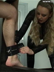 Blonde dominatrix uses her huge strapon on her boy toys throat and asshole