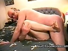 RyAnne Redd ties her slave to a bondage bed, as she prepares to smash and twist his cock and balls.  RyAnne uses her high heels and fishnet stocking covered feet to step on his balls.  She also teases him by stroking his cock with her feet and hands.  When Ryanne is ready, she grabs a vibrator and starts to get herself off.  For the ultimate tease, RyAnne sits right over her slave's hard cock, and puts the vibrator between his cock and her pussy and makes herself cum over and over, while not allowing her slave to cum.