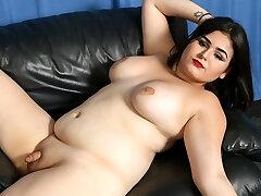 Redhead crossdresser takes her panties down and wanks her hard cock