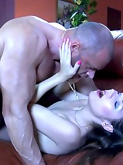 Petite brunette gives a good nylon footjob to a muscled stud and gets boned