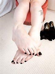 Emma teasing in her black seamed nylons!