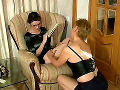 Shy girl in glasses getting seduced into juicy lez action by sexed up milf