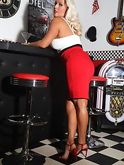 Hot leggy blonde Milf Lana Cox shows her long legs and shaved pussy in an American Diner