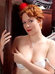 Naughty red American housewife getting frisky