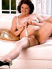 Mature babe masturbating in the living room
