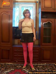 Natural blonde in pink hose and a short skirt
