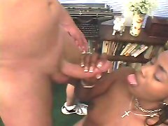 Foxy ebony babe licking and deeply sucking interracial cock