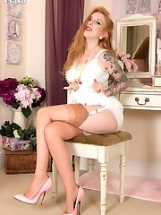 Lovely red head Alexa prepares herself with feminine finery for some sexy passion, in her lingerie, nylons, heels and slip!