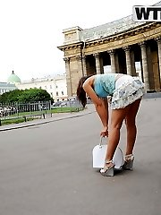 Teenage minx gives a nice head on a public beach - publicsexadventures.com