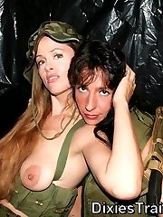 Beautiful military milfs with guns kissing each other