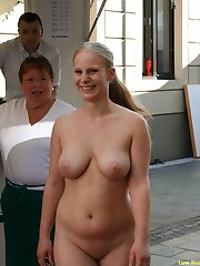 Sexy babe flashes her tits in streets