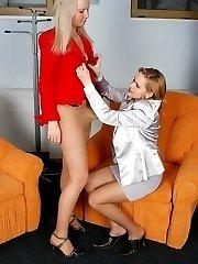 Lusty female co-workers in lacy hose having strap-on break right in office