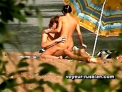 Shaggy nudist gets a back-rubbing on the beach and returns the favor by banging his sexy...