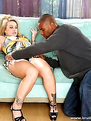 MILF beauty kneels down and sucks on a big throbbing dong