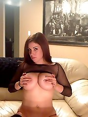Big breasted Sweet Krissy teases in a fishnet top with her big juicy tits