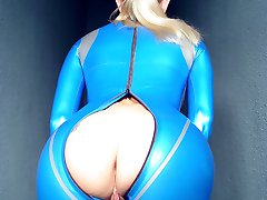 blonde slut in blue latex catsuit with open crotch
