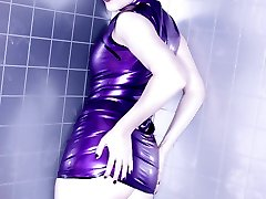 Purple haired Goth girl in purple latex couture