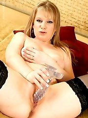 Kessia pinches her nipples as she slides her clear dildo all the way in to her hairless hole,...