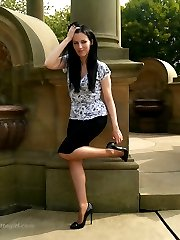 Leggy Tricia is outdoors posing in her silky nylon stockings and black high heels